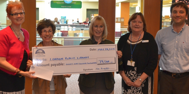 Cheque presentation by Friend of the Library